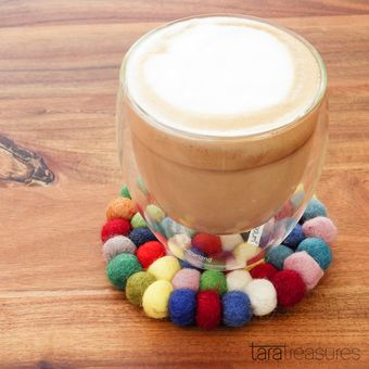 Colourful Cup Coaster. Our most popular colour for felt coasters. Handcrafted from woollen felt balls, this felt coaster protects your table surface when serving hot beverages.