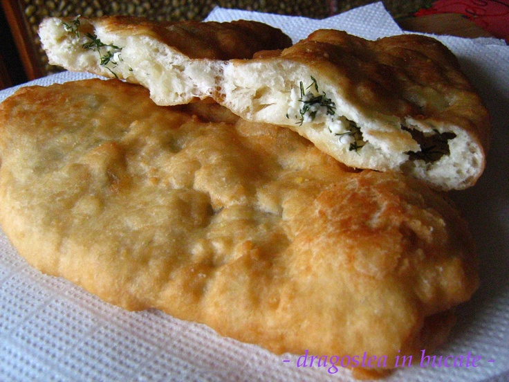 bread dough fried and filled with cheese and dill (langosi cu branza si marar)