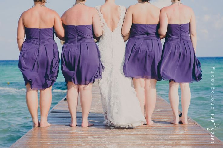 Wedding Photography - Bride with bridesmaids on a pier