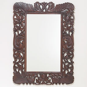 Swap a bathroom vanity mirror for this intricate carved wood mirror. Beautiful and striking against a stark white wall for a Spanish vibe, or pair with rustic bathroom fixtures and deep navy wall color. RICH.     Stained Wood Peacock Mirror | World Market