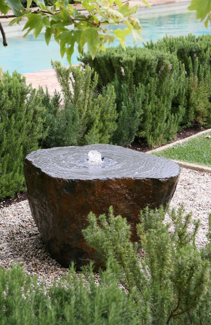 Stone fountain by gardentemple.com in a garden by Joseph Marek Landscape Architecture