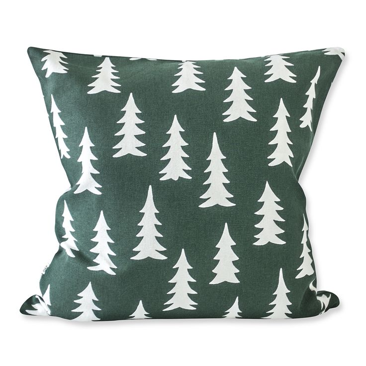 This product is screen printed. Made in India, this cushion cover with firs is inspired by the Scandinavian forest.