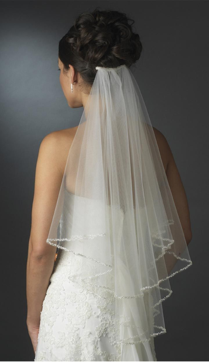 We all know there's nothing more 'wedding' than a wedding veil. Whether it is a a shy white netted blusher or a satin pink Royal veil or even a cute frilly elbow length veil, its what makes the bride seem more… bride-like.