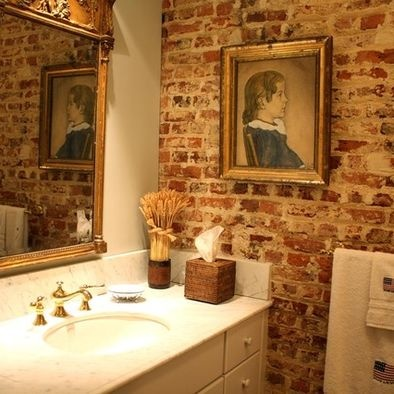 exposed brick in the bathroom. Nice mix of modern and old.
