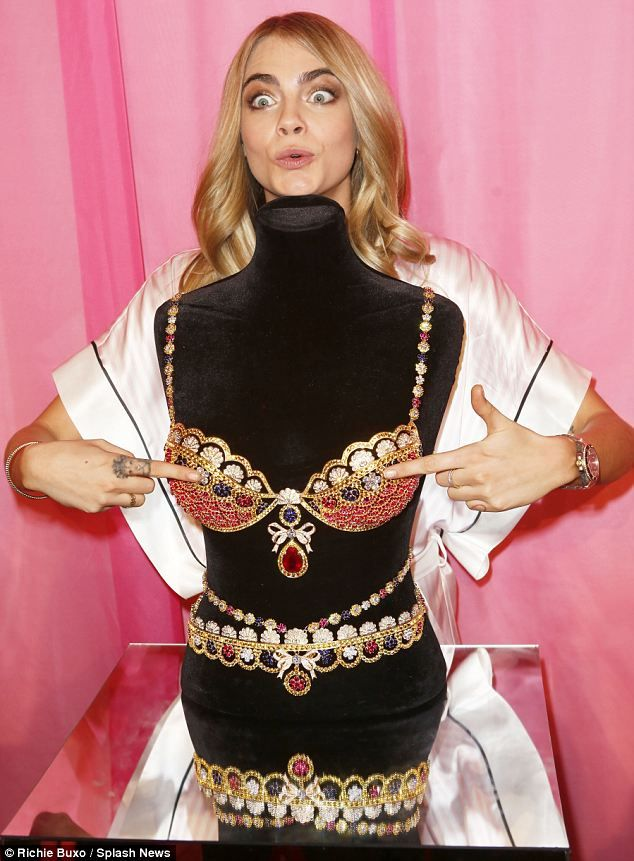 When is it going to be my turn? Cara Delevingne gets up close and personal with the $10 million Royal Fantasy Bra and Belt designed for the ...