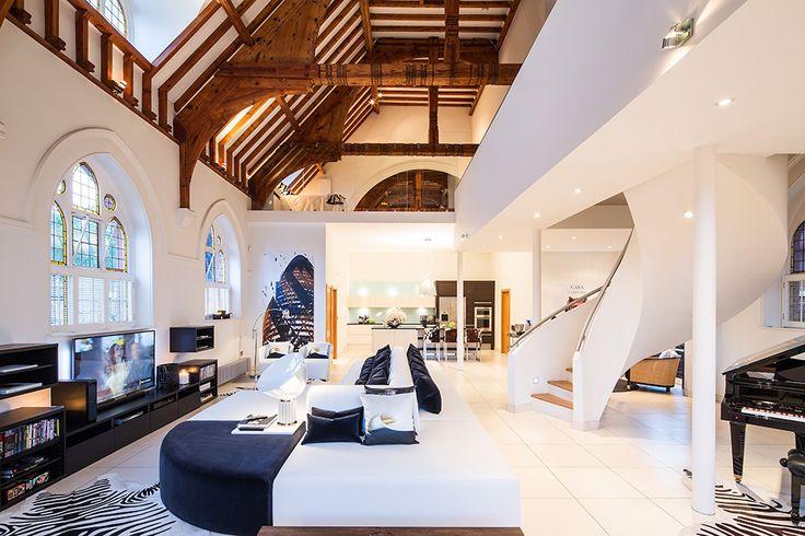 Architectural bureau Gianna Camilotti Interiors converted a historic church into a massive contemporary home in London, UK.