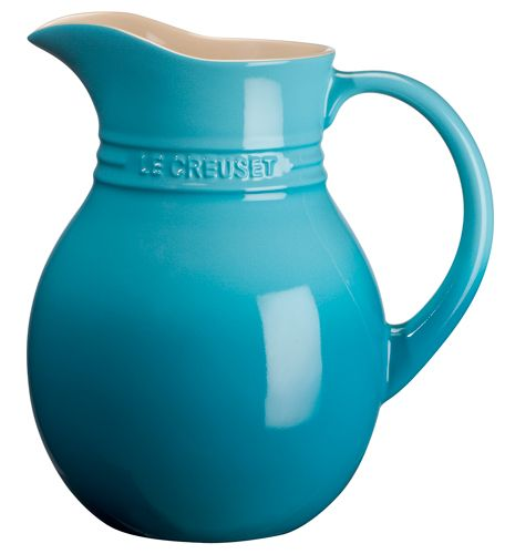Le Creuset's Sangria Pitcher has a large, sturdy handle so you can get a good grip, and the spout is artfully curved but also designed to prevent spills while you pour liquid that also has ice and fruit in it. The pitcher is built to handle all sorts of extreme hot and cold temperature. color is Caribbean