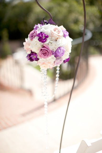 Beautiful purple aisle decoration. Flowers by Splendid Sentiments