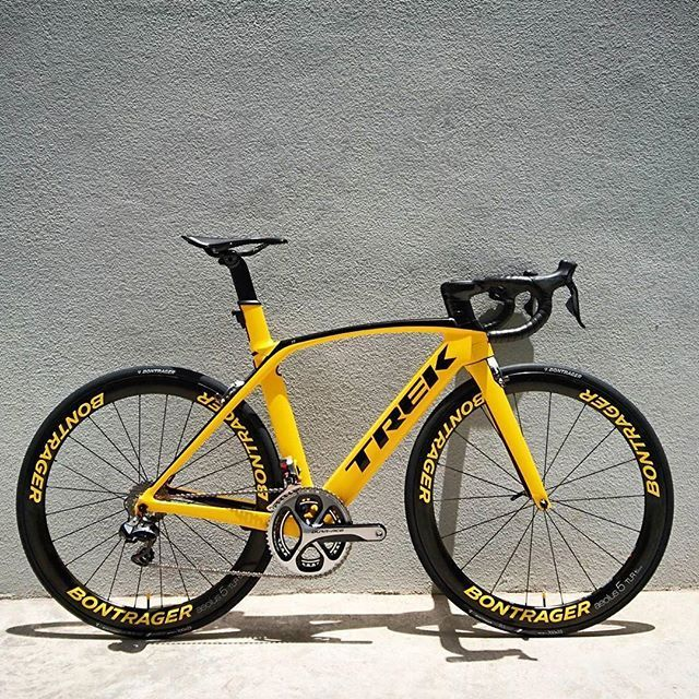 Super Sporty looking Trek Madone! It kind of reminds you of a yellow Ferrari…