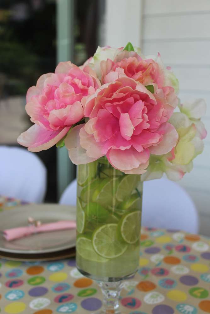 Floral centerpieces at a Mexican baby shower party! See more party planning ideas at CatchMyParty.com!