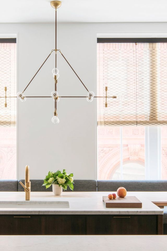 Draw the gaze up with a statement chandelier. If your renovated kitchen seems a bit stark and unfinished, consider statement lighting. This sculptural chandelier is illuminated by floor-to-ceiling...