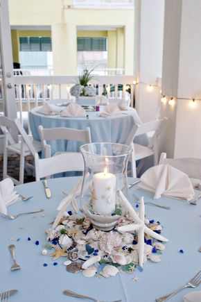Light blue is a great option for a beachy wedding. Love these laidback centerpieces! #somethingblue #beachwedding #weddingdecor