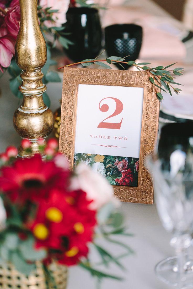 Bronze metallic frame for this elegant table setting!  #tablenumbers #bronze #gold #red #black #elegant #weddingplanner #dreamsinstyle