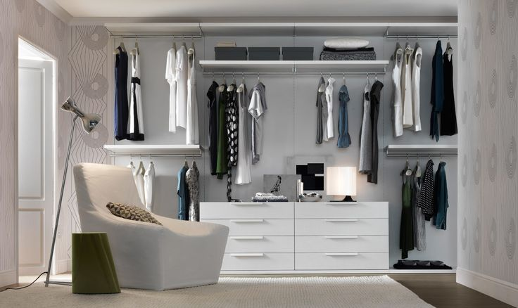Custom Closets manufactured by Jesse of Italy, designed by Pomp Home of Los Angeles.  New All white collection is added to walnut and espresso lines for 2012.  www.pomphome.com