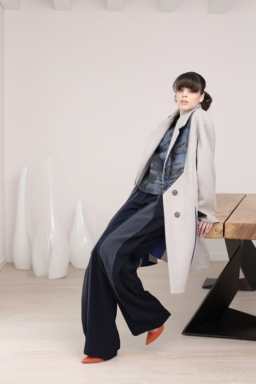One of MARTA CUCCINIELLO's signature are the folds of the pants, like for the large or slim Cady ones. http://blog.martacucciniello.com/post/89034820674/designers-signature-the-folds