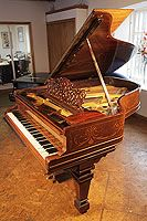 Steinway model A grand piano for sale with a rosewood case. Cabinet features satinwood stringing inlay