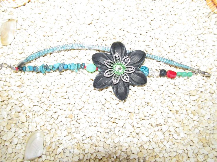 Handmade bracelet (1 pc)  Made with leather and metal flower, leather cord inside of a metal basket, gemstones and glass beads.