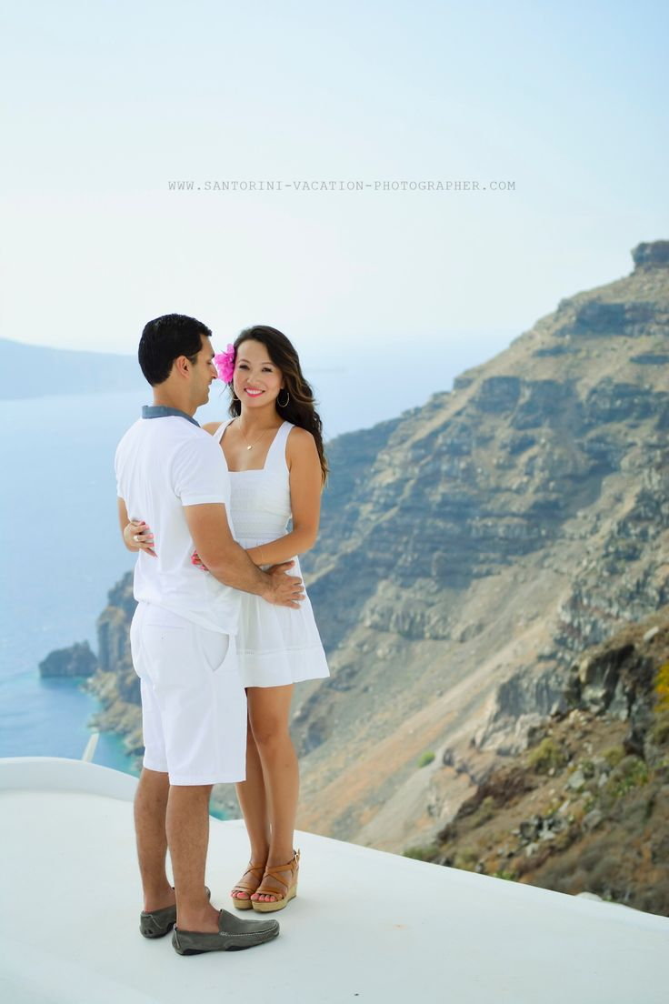 Another happy couple in love. Oia village, Santorini island, Greece - selected by www.oiamansion.com