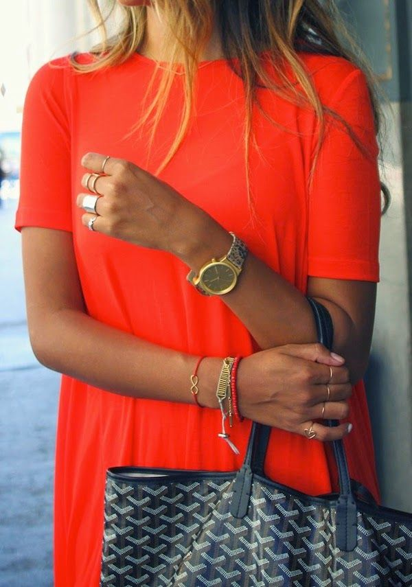 tangerine dress + silver rings.