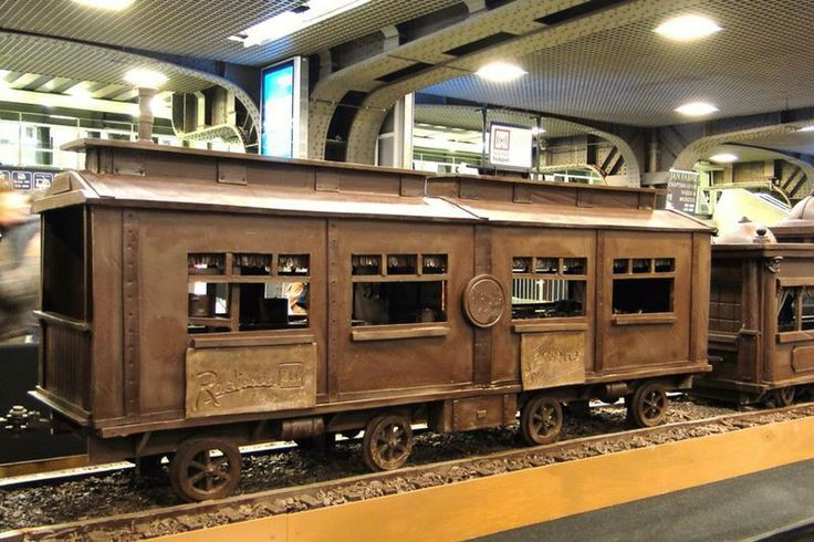 SENDING PHOTOGRAPHS OF   Train Made Entirely of Chocolate           A train made entirely of chocolate has set a new Guinness World Record as the longest chocolate structure in the world.         The sculpture, on display at the busy Brussels South station, is 112-feet (34.05 meters) long and weighs over 2,755 pounds (1250 kilos).            Maltese chocolate artist Andrew Farrugia spent over 700 hours constructing the masterpiece.