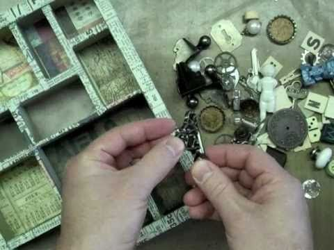 Tim Holtz invites you to discover the tips and tricks of creating your own idea-ology configurations shadow boxes...  (this is part 2 of 2 videos)