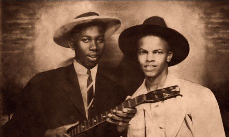 Robert Johnson poses with fellow blues musician Johnny Shines in the newly released photograph. Photograph: Robert Johnson Estate/Getty Images. 3rd picture ever found of Johnson.