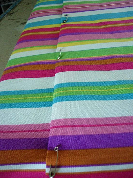 No sew cushion covers using safety pins.  Nice if you plan on changing often.  Wrap like a present and use safety pins to secure.