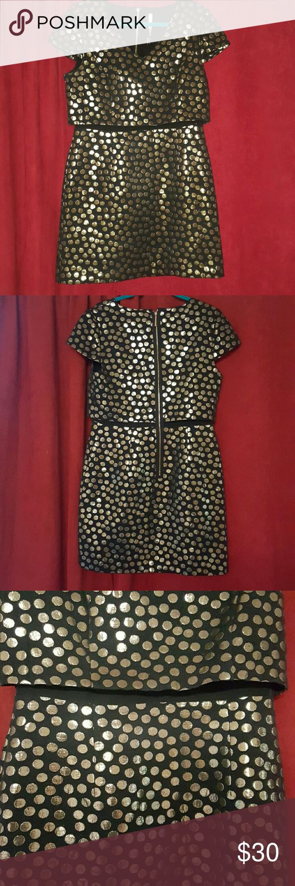 Black and Metallic Gold Polka Dot Kensie Dress This chic, modern dress is perfect for a night out or any semi formal event. The top and bottom are connected by a black fabric, which gives the illusion of a two piece look, with all the comfort of a one piece dress. Kensie Dresses Mini