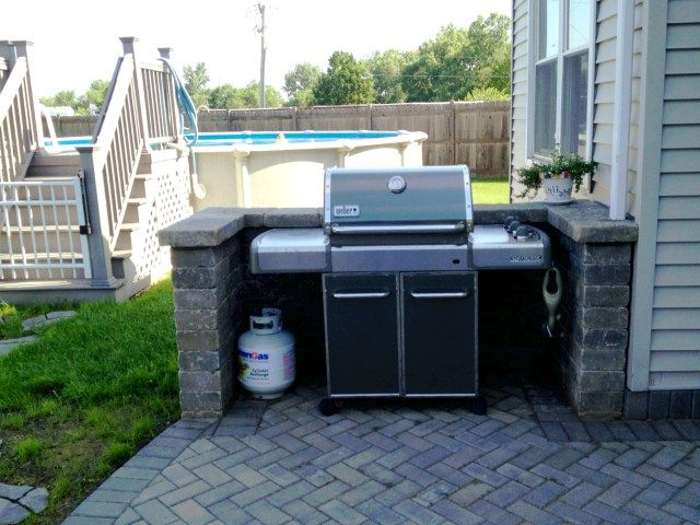 Stone grill surrounds offer an aesthetically pleasing space for your grill.  Designed and built by Archadeck of Chicagoland.