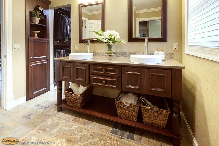 Door style: Windsor | Species: Cherry | Stain: Brandy  Upstairs, the master bath strikes out in a new creative direction, using the Windsor door style in warm cherry. The Showplace furniture vanity offers a lot of visual interest, with its large turned legs, open lower shelf, and freestanding appearance.  Learn more about our Windsor door style: http://www.showplacewood.com/DOORS/windsor/Doors.Windsor.html