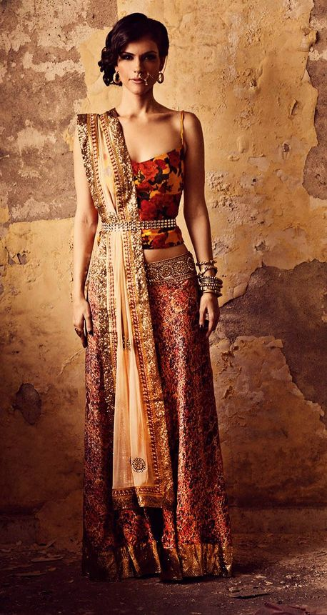 Stunning piece from Sapana Amin's Bohemian-Rani Festive Collection 2013. Beautiful choice of colors & patterns! Golden borders give the lehenga an extremely rich look--love!