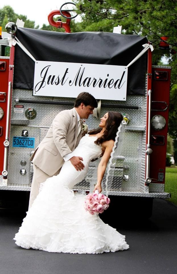 Fireman wedding pic in front of his truck