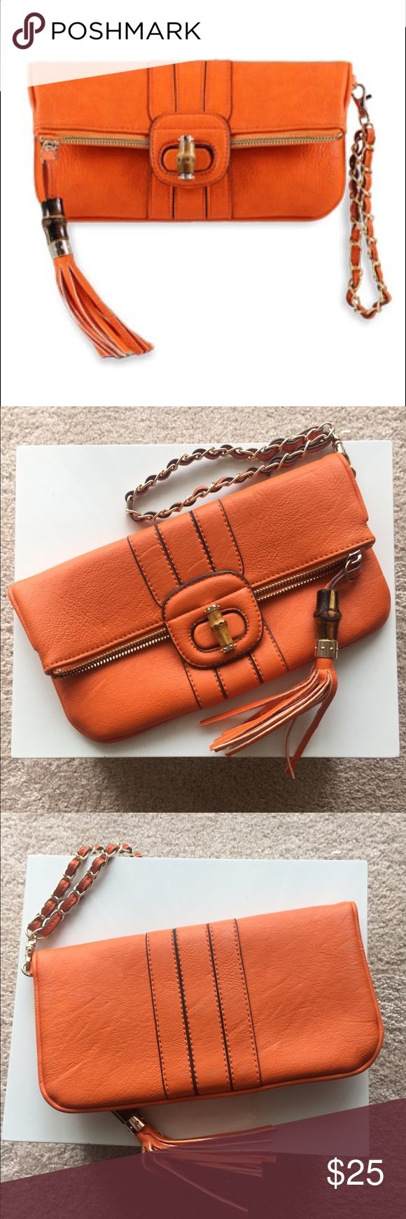 Melie Bianco Equestrian Orange Bamboo Clutch Equestrian orange foldover clutch with wristlet, which makes it very functional. Approximately 9.5 inches long and roughly 6 inches tall when folded over. Melie Bianco Bags Clutches & Wristlets
