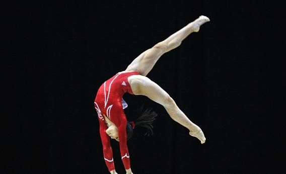 ivana hong stanford | Ivana Hong of the U.S. performs her routine on the beam during the ...