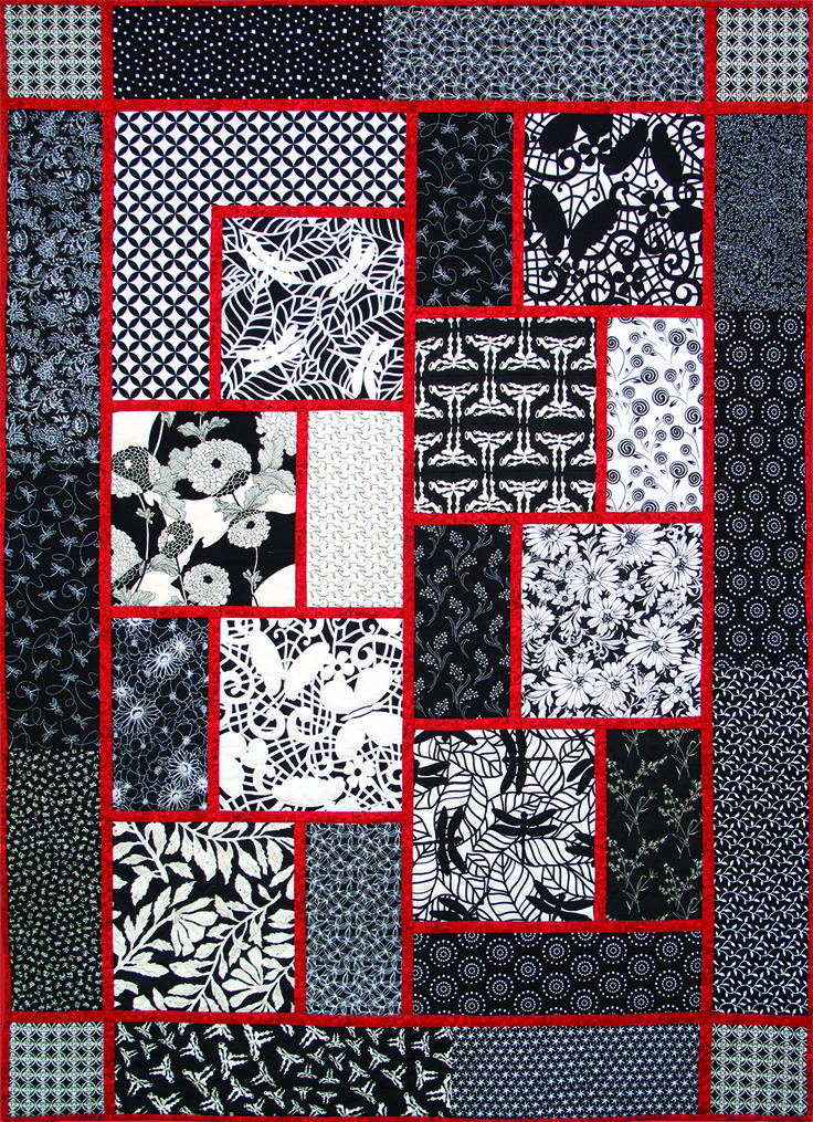 Here's the original Big Block Quilt done in black, red and white fabrics. Posted at The Creative Quilter.  pattern by Black Cat Creations.