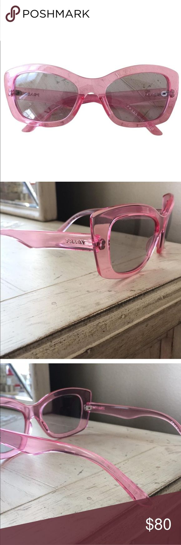 """Prada sunglasses Fun pink Prada cateye sunglasses! Only worn a couple times with no sign on wear. Comes with case and cloth. """"Prada"""" lightly etched in upper corner of the lens- tried to capture it in a picture but it is difficult to see. Prada Accessories Sunglasses"""