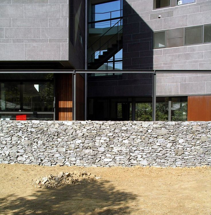 View of the stone wall facing west.  http://www.hjlstudio.com/suip-777-residence