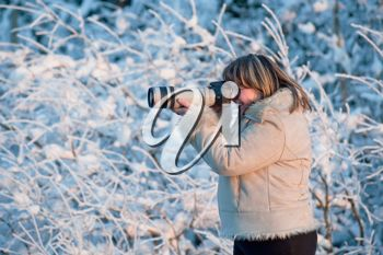Royalty Free Photo of a Woman Taking Pictures in the Winter