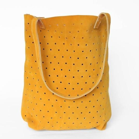Mustard suede has never looked so lovely. This bag is perfect for adventuring out to a farmers market or a sunny picnic,