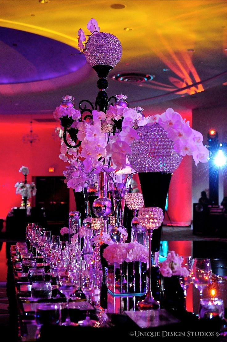 Modern black crystal and orchid centerpieces for Silla quinceanera