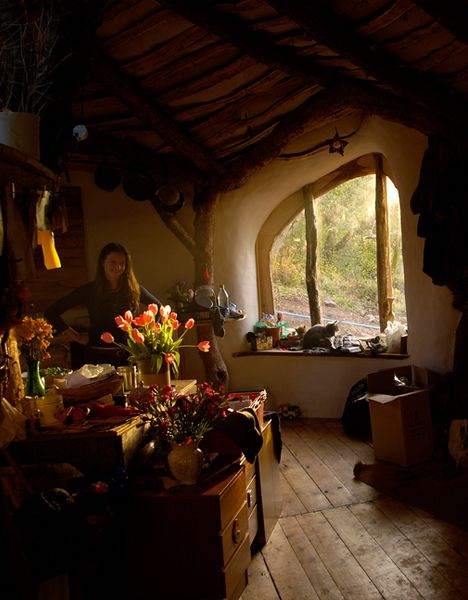 Hobbit house ~ the idea of designing and building your own is appealing. I will do this one day.