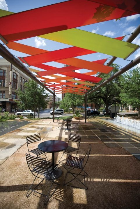 Colorful fabric shade structures designed by Rios Clementi Hale architects invite passers-by to enjoy San Antonio's Main Plaza in the heart of town. The structures recently won an IAA 2010 Award of Excellence for exterior shade from the Industrial Fabrics Association International annual awards program, and are a vital piece of ongoing redevelopment of downtown San Antonio. Architect of record is Duende Design Architects, fabricator The Chism Co., fabric is Soltis86 from Ferrari Textiles.