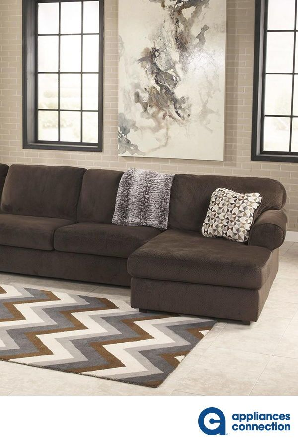 The Ample Seating Area Of The Jessa Place Sectional Is Covered With Plush Fabric Upholstery The Sectional Modular Sectional Comfortable Sectional Sofa Design