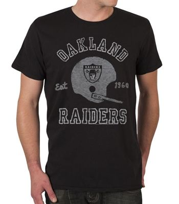 Oakland Raiders Shirt by Junk Food  This officially licensed NFL shirt by Junk Food features a vintage print of the Oakland Raiders team helmet along with the year the team was established.    Fabric Details        Color: Black Wash      100% cotton    Our Price: $24.95