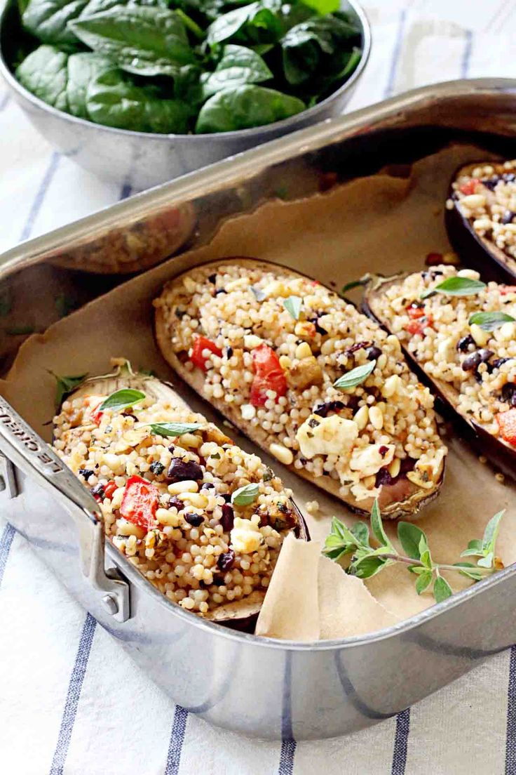 Israeli Couscous Stuffed Eggplant with Feta, Olives, and Tomatoes