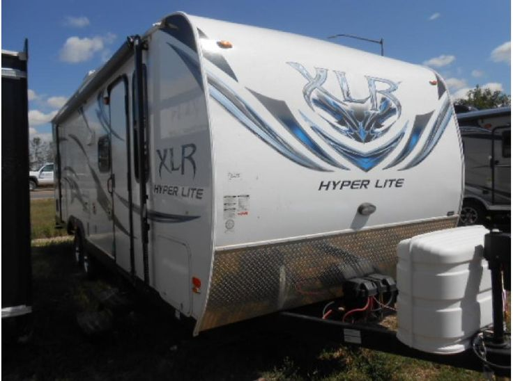 Get most affordable deals on Cheap Used 2012 #Forest_river Xlr Hyperlite 27HSF #Travel_trailer by Eastside RVs for $24989 in Gillette, WY, USA. The 2012 Forest River Xlr Hyperlite 27hsf is Available in good and clean condition.It's White With Black Label Interior with included 2 Burner Cook Top, Microwave, And Camp Side Window For Natural Light In The Kitchen. If you're interested to see more details, then click to log on At: http://goo.gl/hDwPEc