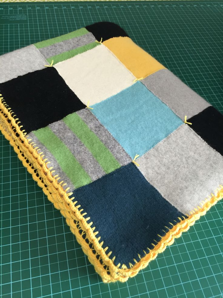 Recycled cashmere/wool sweater quilt sewn edge-to-edge with clear thread with crochet trim...