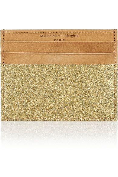 Shop now: Maison Martin Margiela.