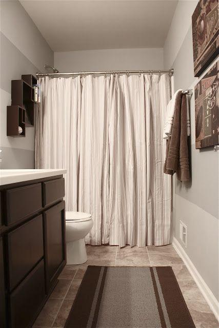 Boy's Bathroom Reveal~Using Two Shower Curtains. striped bathroom walls. Sports.