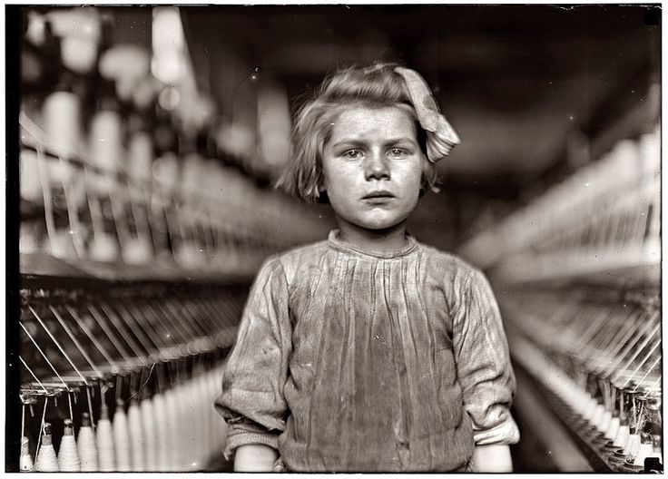 Lewis Hine - A little spinner in Globe Cotton Mill. Augusta, Ga. The overseer admitted she was regularly employed. Location: Augusta, Georgia.  https://www.loc.gov/pictures/collection/nclc/item/ncl2004001390/PP/
